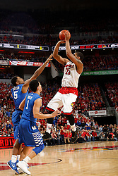Louisville guard/forward Wayne Blackshear, right, shoots over Kentucky guard Devin Booker and guard Andrew Harrison in the second half. Blackshear finished with 10 points and was 2-9 from the field. Kentucky won 58-50.<br /> <br /> The University of Louisville hosted the University of Kentucky, Saturday, Dec. 27, 2014 at Yum Center in Louisville. <br /> <br /> Photo by Jonathan Palmer