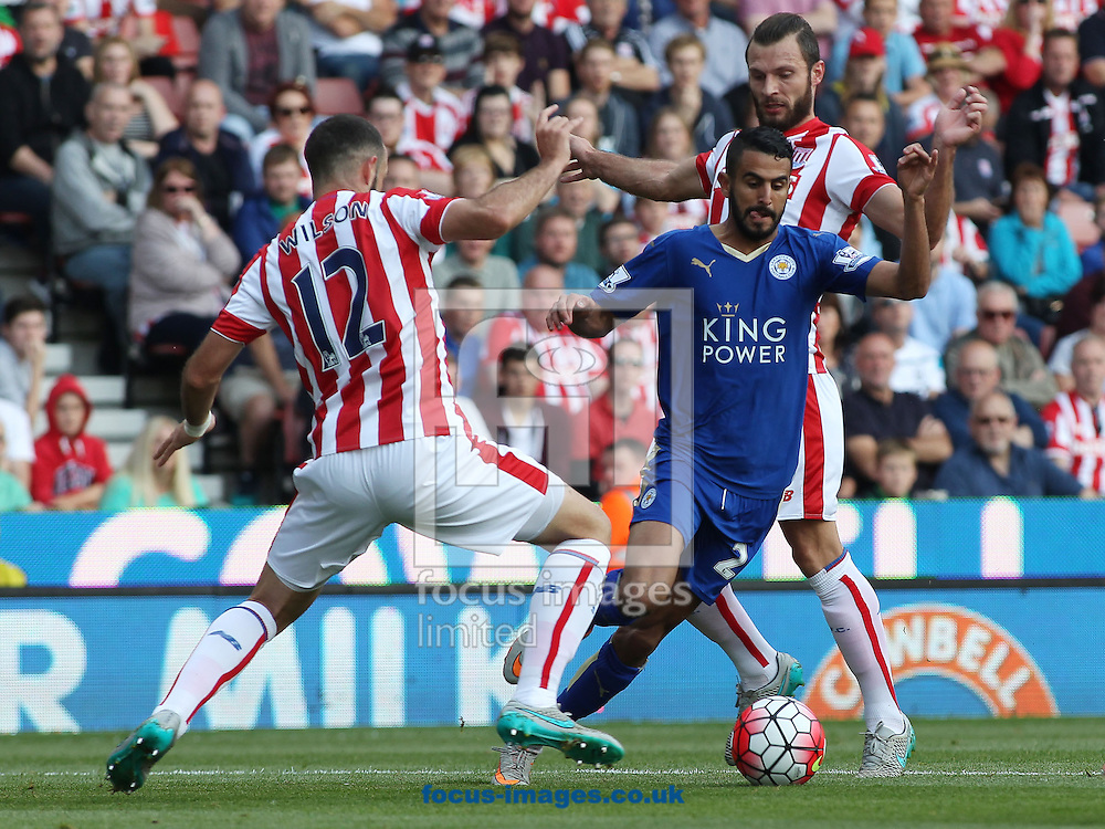 Marc Wilson of Stoke City and Riyad Mahrez of Leicester City in action during the Barclays Premier League match at the Britannia Stadium, Stoke-on-Trent.<br /> Picture by Michael Sedgwick/Focus Images Ltd +44 7900 363072<br /> 19/09/2015