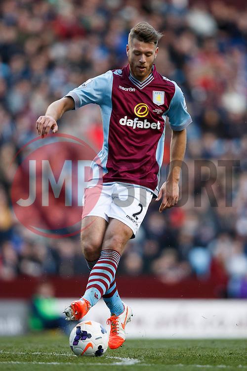 Aston Villa Defender Nathan Baker (ENG) in action - Photo mandatory by-line: Rogan Thomson/JMP - 07966 386802 - 23/03/2014 - SPORT - FOOTBALL - Villa Park, Birmingham - Aston Villa v Stoke City - Barclays Premier League.
