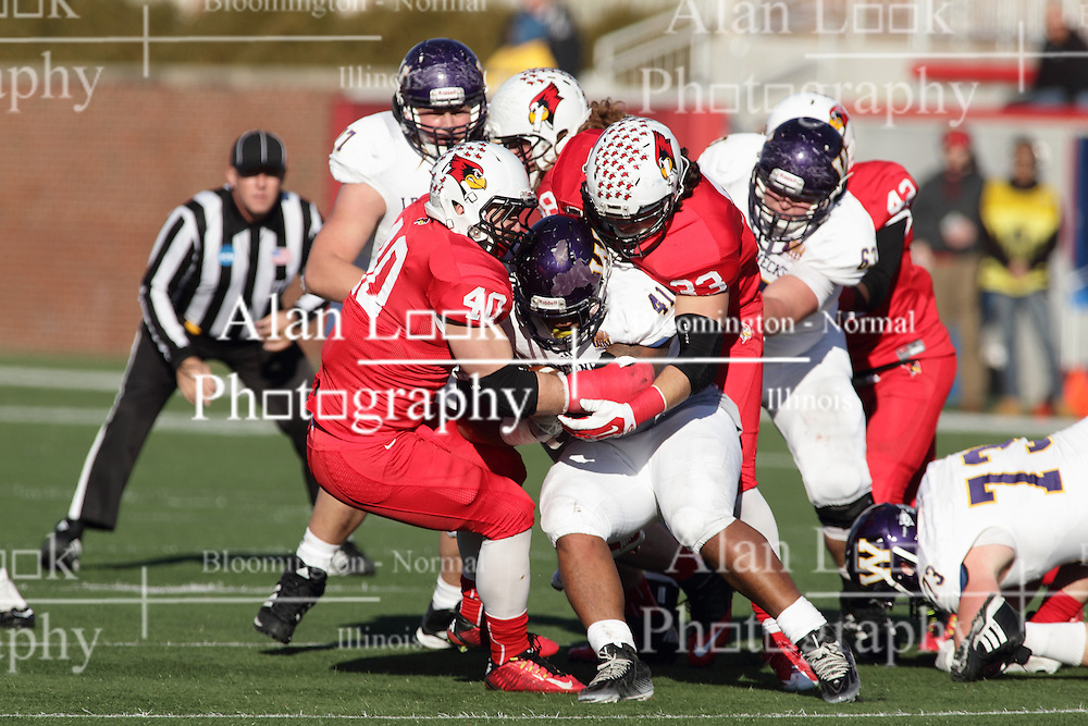 05 December 2015:  Alex Donnelly(40) and Pat Meehan(33) share the tackle of Nikko Watson(41). NCAA FCS Round 2 Football Playoff game between Western Illinois Leathernecks and Illinois State Redbirds at Hancock Stadium in Normal IL (Photo by Alan Look)