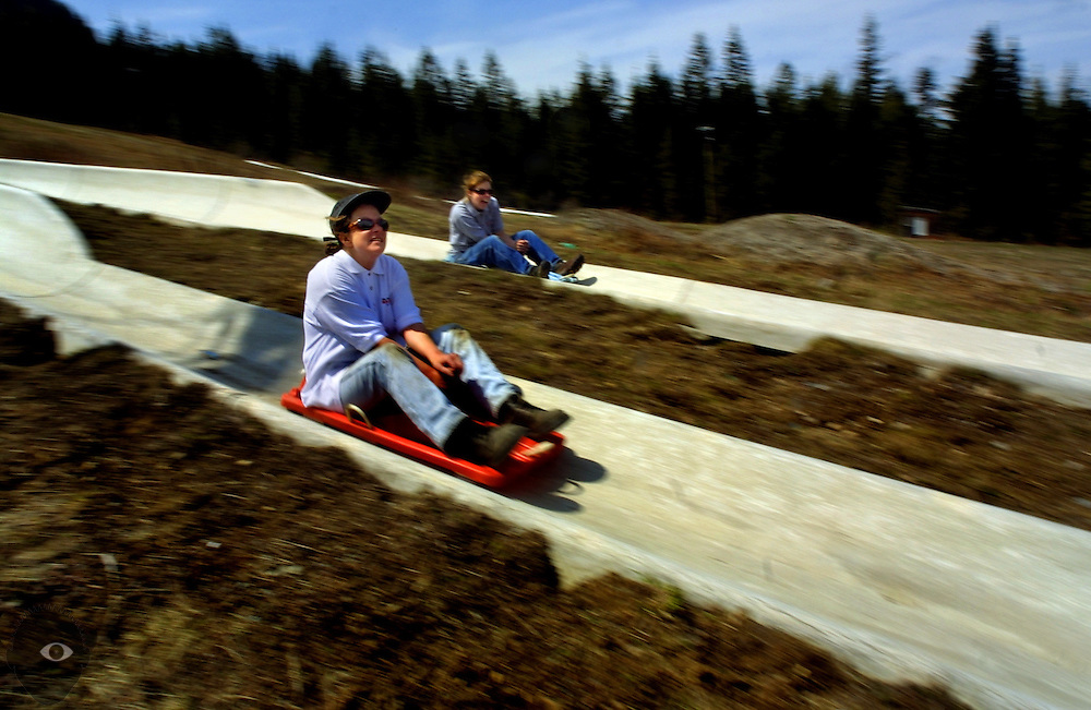 Frances Martinez and Jill Callaco take a ride down the Alpine slide at Government Camp on Mt. Hood in Oregon. As employees there they are helping to ready the track for their Summer crowd which also features  mountain biking and hiking trails.