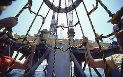 Stock photo of a personnel basket bringing crew onboard an offshore drilling rig