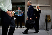 """Trouble on Wall Street. A trader reads the Metro newspaper which has the headline """"Wall Street Massacre"""" on the front. The newspaper headline came after the start of the 2008 recession caused by failing housing market and subprime bundling scandal."""
