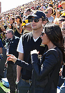 September 11 2010: Ashton Kutcher and Demi Moore before the start of the first half of the NCAA football game between the Iowa State Cyclones and the Iowa Hawkeyes at Kinnick Stadium in Iowa City, Iowa on Saturday September 11, 2010. Iowa defeated Iowa State 35-7.