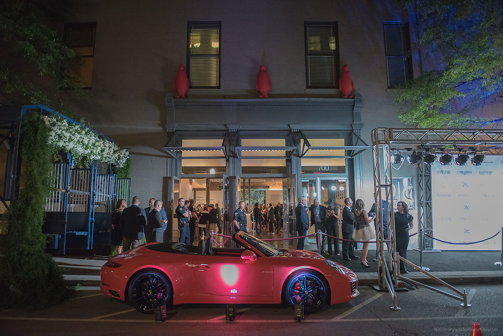 A red Porsche sits outside to 21c Museum Hotel where the black carpet leads  the entrance of the Vanity Fair Derby party. May 6, 2016