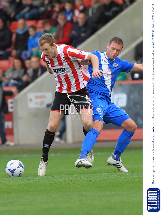 Kyle Storer and Andy Drury during the Vanarama National League match between Cheltenham Town and Eastleigh at Whaddon Road, Cheltenham, England on 17 October 2015. Photo by Antony Thompson.
