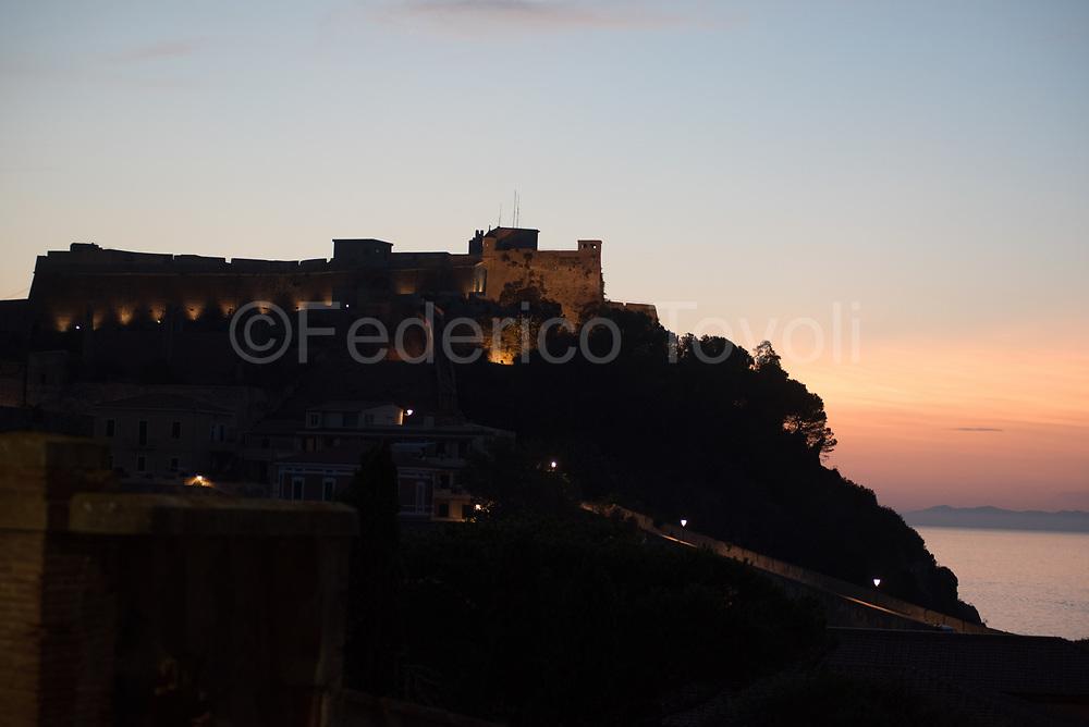 Portoferraio. Le Viste beach at dusk with Falcone fort's silhouette