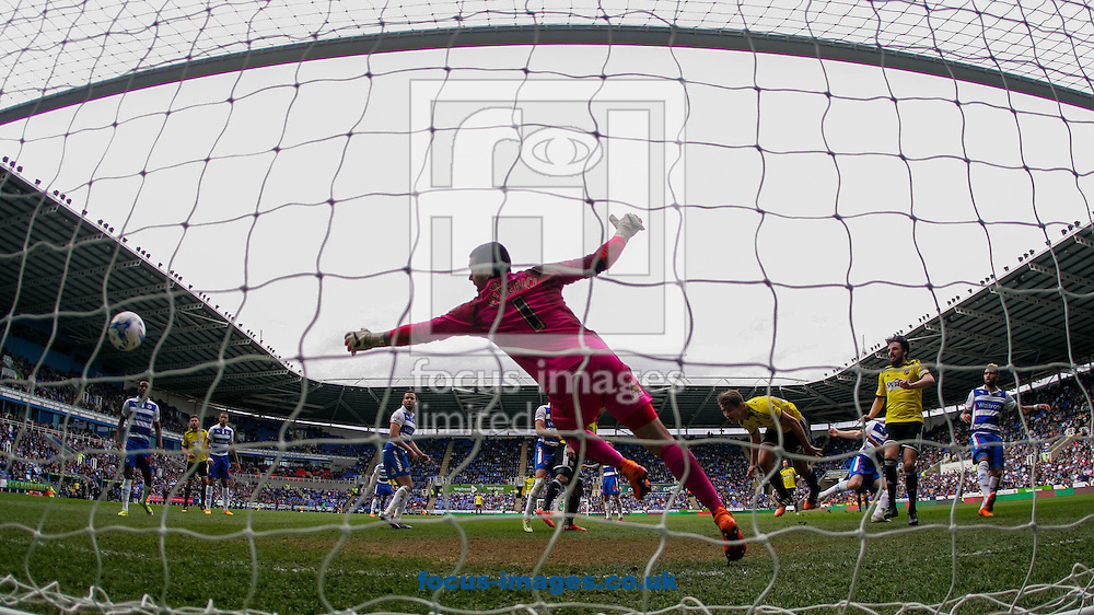 James Tarkowski of Brentford scores Brentford's second goal past Adam Federici of Reading during the Sky Bet Championship match between Reading and y of Brentford at the Madejski Stadium, Reading<br /> Picture by Mark D Fuller/Focus Images Ltd +44 7774 216216<br /> 25/04/2015