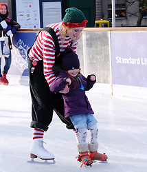 Edinburgh's Christmas 2016, Friday 18th November 2016<br /> <br /> The Edinburgh's Christmas Ice Rink in St Andrew's Square opened to the public today.<br /> <br /> A skating elf takes to the ice to help learners, young and old alike.<br /> <br /> (c) Alex Todd | Edinburgh Elite media