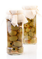Studio shot of pickled olives in jar
