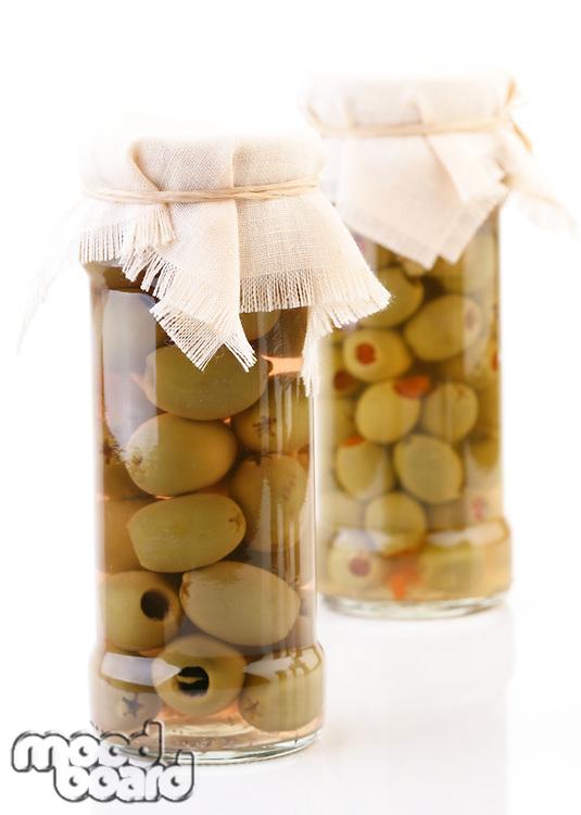 Studio shot of pickled olives in jar