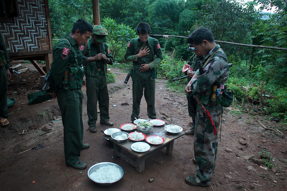 KIA's members pray before the breakfast in the Rubber Hill Post in the front line of Laja Yang village outskirts of Laiza, Kachin State, Myanmar on August 8, 2012, most of the Kachin people are Christians. The KIA formed in 1961 in response to a military coup in Burma led by General Ne Win, who attempted to consolidate Burmese control over regions on the periphery of the state which were home to various ethnic groups. From 1961 until 1994, the KIA fought a grueling and inconclusive war against the Burmese junta. In 2011, general Sumlut Gun Maw confirmed renewed fighting in the state of Kachin for independence. One of the new reasons for the ending of the ceasefire is the creation of the Myitsone Dam which requires the submergence of dozens of villages in Kachin state.