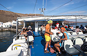 Passengers on boat trip from Orzola to Graciosa island, Lanzarote, Canary Islands, Spain