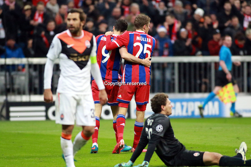 11.03.2015. Allianz Stadium, Munich, Germany. UEFA Champions League football. Bayern Munich versus Shakhtar Donetsk.  Thomas Muller, Robert Lewandowski (FC Bayern) celebrate as Dario Srna, and keeper Andriy Pyatov  (FC Schachtar Donezk )look on dejected The game ended 7-0 to Bayern over Shakhtar.