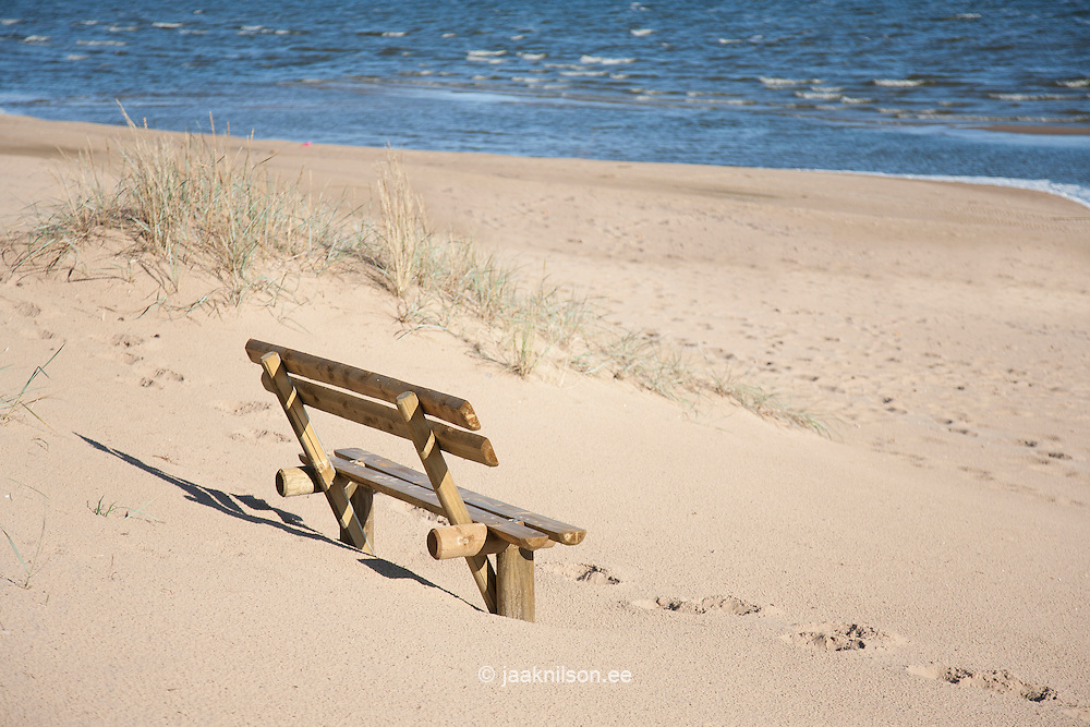 wooden bench on empty beach