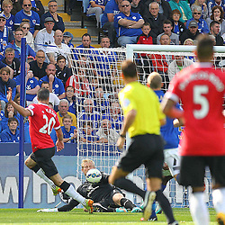Manchester United's Robin Van Persie shoots at Leicester City's Goalkeeper Kasper Schmeichel during the Barclays Premiership match between Leicester City FC and Manchester United FC, at the King Power Stadium, Leicester, 21st September 2014 © Phil Duncan | SportPix.org.uk