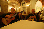 "Guitar players Jose Carvalhinho (left) and Manuel Mendes (right) perform every night at the restaurant ""Marques da Se"", one of the main Fado venues in Lisbon."