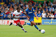 AFC Wimbledon defender Nesta Guinness-Walker (18) battles for possession with Rotherham United defender Matthew Olosunde (22) during the EFL Sky Bet League 1 match between AFC Wimbledon and Rotherham United at the Cherry Red Records Stadium, Kingston, England on 3 August 2019.