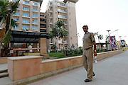 A Delhi Policeman patrols the Games Village. Media visit to the Games Village. XIX Commonwealth Games, New Delhi, India. Friday 1st September 2010 September 2010. Photo: Simon Watts / photosport.co.nz
