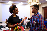 Keena Atkinson, left, speaks with Robert Murphy during the Black Excellence Youth Conference at the Best Western Plus Inntowner on Monday, Jan. 15, 2018.