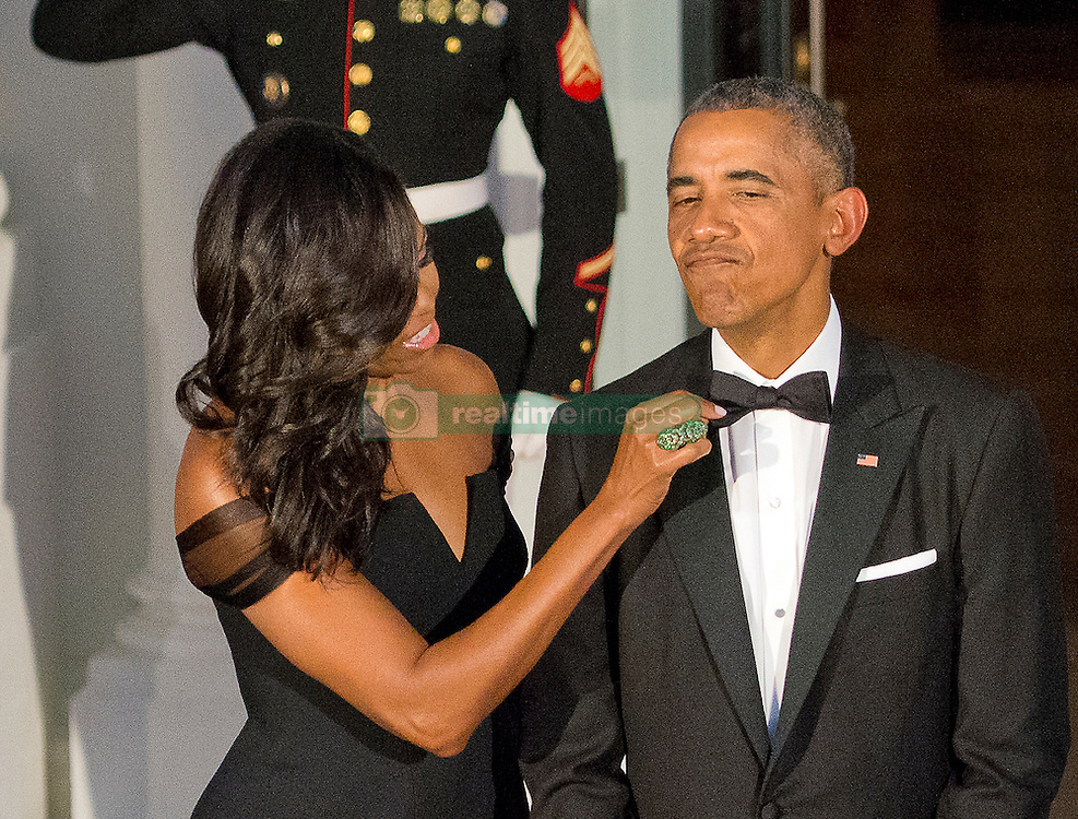 First Lady Michelle Obama adjusts the tie of United States President Barack Obama as they prepare to welcome President XI Jinping of China and Madame Peng Liyuan to a State Dinner in their honor on the North Portico of the White House in Washington, DC on Friday, September 25, 2015.<br /> Credit: Ron Sachs / CNP /ABACAPRESS.COM  | 517214_004 Washington Etats-Unis United States