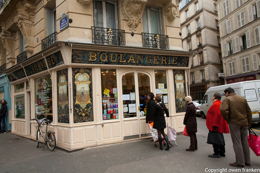 Sunday at the Bakery of Jacques Bazin, Paris..Lines outside the bakery