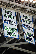 SEATTLE - SEPTEMBER 24:  Two banners commemorating the Seattle Seahawks winning the NFC West divisional championship on display prior to the New York Giants at Qwest Field on September 24, 2006 in Seattle, Washington. The Seahawks defeated the Giants 42-30. ©Paul Anthony Spinelli