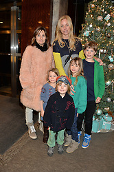 Left to right, DAISY BATES her son (wearing hat) WOODY, KATE DRIVER and her children LILY STILLMAN, JESSICA STILLMAN (green top) and PERCY STILLMAN at a VIP evening hosted by Joely Richardson at the Tiffany & Co Christmas Shop, Tiffany & Co Old Bond Street, London on 24th November 2013.