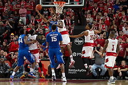 Louisville forward/center Chinanu Onuaku, center, contests a shot by Kentucky forward Trey Lyles in the second half. Kentucky won 58-50.<br /> <br /> The University of Louisville hosted the University of Kentucky, Saturday, Dec. 27, 2014 at The Yum Center in Louisville.