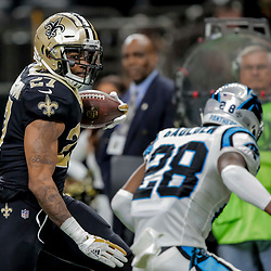 Dec 30, 2018; New Orleans, LA, USA; New Orleans Saints running back Dwayne Washington (27) runs against Carolina Panthers safety Rashaan Gaulden (28) during the second half at the Mercedes-Benz Superdome. Mandatory Credit: Derick E. Hingle-USA TODAY Sports