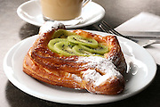 Cheese and Kiwi Puff pastry or breakfast pastry in a bakery shop