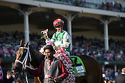 Jockey Javier Castellano celebrates after riding Cathryn Sophia to win the Longines Kentucky Oaks, Friday, May 6, 2016, in Louisville, Ky.   Longines, the Swiss watch manufacturer known for its luxury timepieces, is the Official Watch and Timekeeper of the 142nd annual Kentucky Derby. (Photo by Diane Bondareff for Longines/AP Images)
