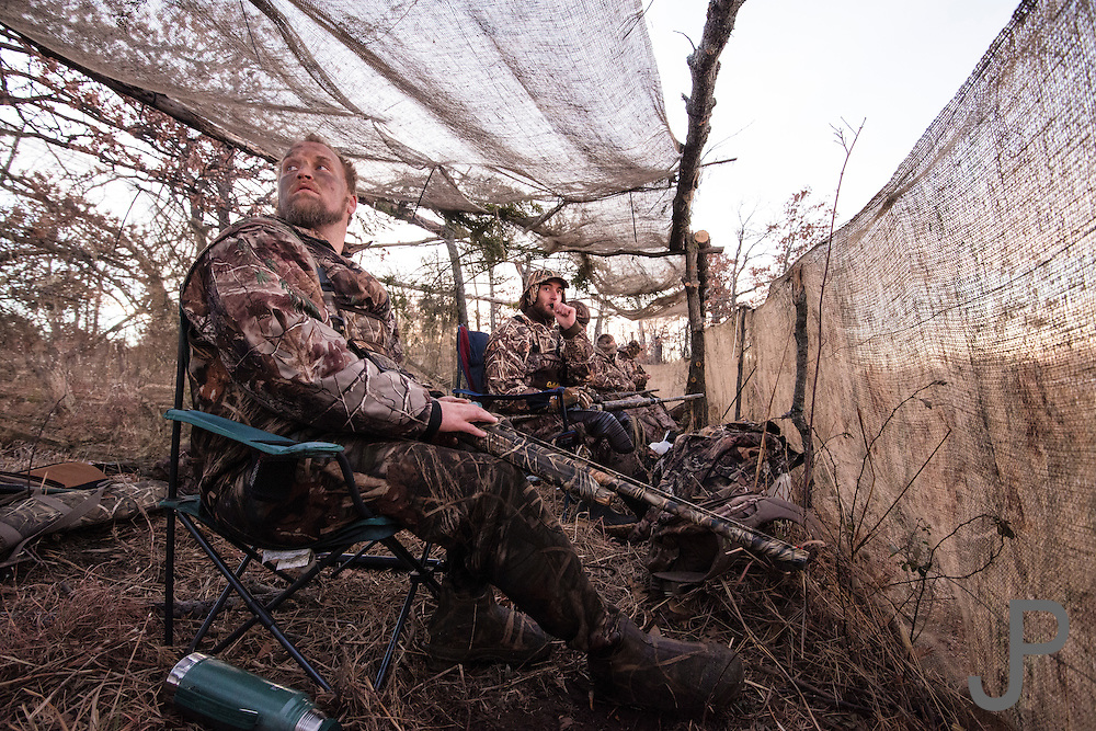 Gary Friend from Bartelsville, OK looks for incoming ducks while hunting in  Shamrock, OK