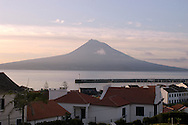 Traditional white houses and architecture in Horta, Faial Island, with Pico volcano on the background at sunrise, Azores Islands, Portugal, North Atlantic Ocean &amp;#xA;&copy; KIKE CALVO &amp;#xA;<br />
