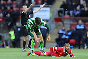 George Francomb of AFC Wimbledon takes a tumble during Sky Bet League 2 match between Leyton Orient and AFC Wimbledon at the Matchroom Stadium, London, England on 28 November 2015. Photo by Stuart Butcher.