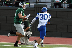 12 October 2013:  Tate Musselman hoofs it left turning and heads up the home sideline before encountering Taylor Simental during an NCAA division 3 football game between the North Park vikings and the Illinois Wesleyan Titans in Tucci Stadium on Wilder Field, Bloomington IL