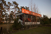 An overgrown miniature version of the enclosed viewing stands at the nearby Rockingham Speedway, which escaped a similar fate after Andy Hillenburg purchased the famed NASCAR track at a public auction for four million dollars.