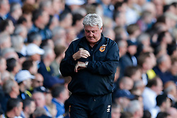 Hull City Manager Steve Bruce looks down at his watch with time running out and his side losing 2-0 - Photo mandatory by-line: Rogan Thomson/JMP - 07966 386802 - 16/05/2015 - SPORT - FOOTBALL - London, England - White Hart Lane - Tottenham Hotspur v Hull City - Barclays Premier League.