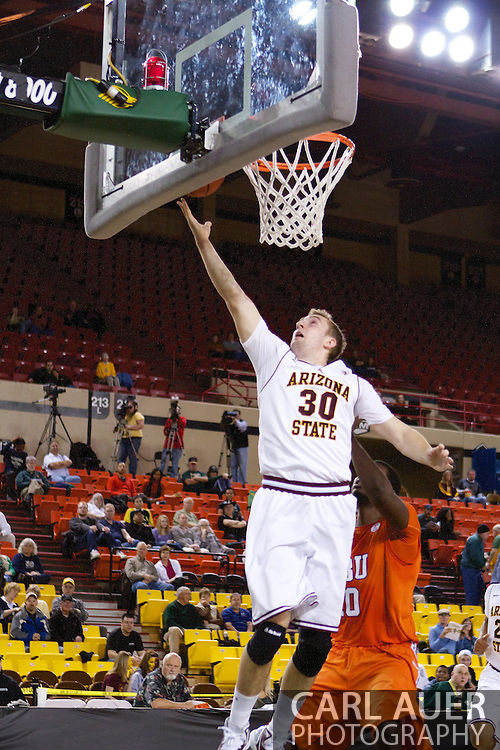 November 25th, 2010:  Anchorage, Alaska - Arizona State forward Rihards Kuksiks (30) attempts a lay up in the Sun Devils 73-55 win over Houston Baptist at the Great Alaska Shootout.