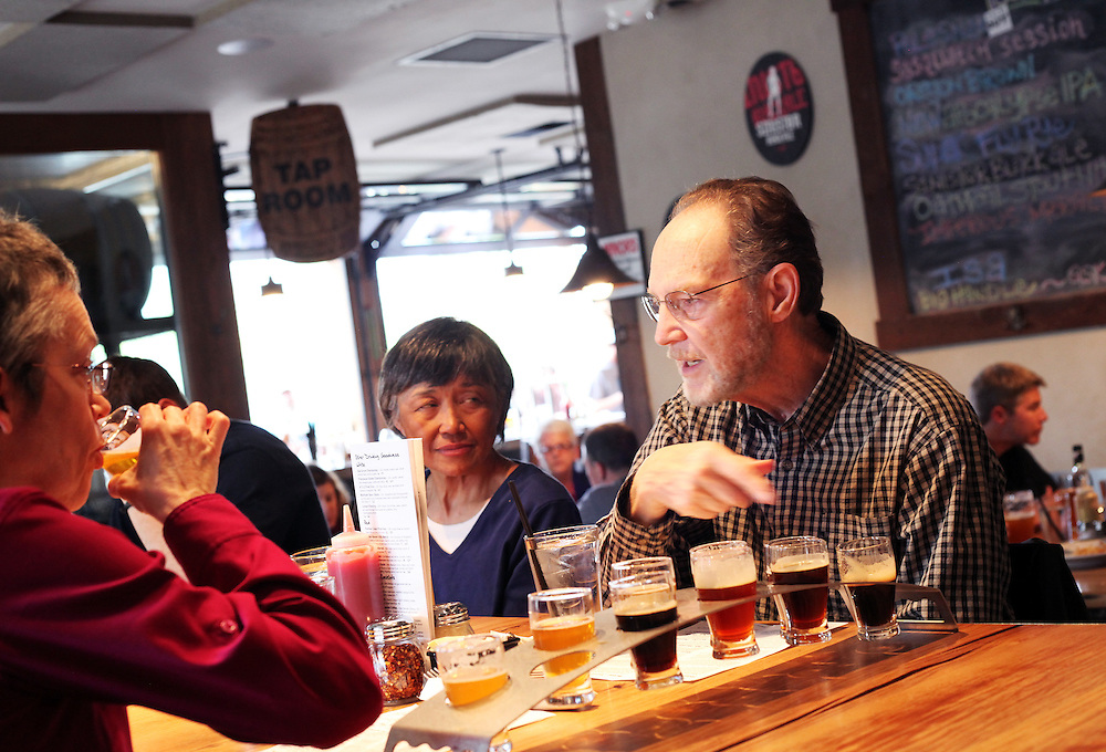 Ray Lambeth learns about his 10-beer sampler at 10 Barrel Brewing Company. Craft beer permeates the culture in Central Oregon city of Bend, with 10 breweries serving pints, growlers and kegs to a community of less than 90,000. Photographed Wednesday, April 25, 2012. Assignment ID 30125094A
