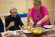 Residents cook and eat dinner with staff at Windswept rehabilitation unit, Sandalwood Court, Swindon.