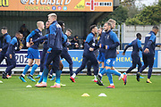 AFC Wimbledon players warming up during the The FA Cup match between AFC Wimbledon and Doncaster Rovers at the Cherry Red Records Stadium, Kingston, England on 9 November 2019.