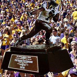Oct 2, 2010; Baton Rouge, LA, USA; LSU Tigers fans hold up a mock up of  cornerback Patrick Peterson (7) on the Heisman Trophy prior to kickoff of a game between the LSU Tigers and the Tennessee Volunteers at Tiger Stadium.  Mandatory Credit: Derick E. Hingle