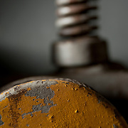 Close-up vignettes of machinery in small industrial machine shop.