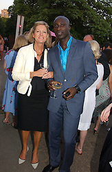 Fashion designer OZWALD BOATENG and LADY CONRAN at the Serpentine Gallery Summer party sponsored by Yves Saint Laurent held at the Serpentine Gallery, Kensington Gardens, London W2 on 11th July 2006.<br />