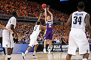 ST. LOUIS, MO - MARCH 26: Jake Koch #20 of the Northern Iowa Panthers takes a three-point shot against the Michigan State Spartans during the Midwest regional semi-final of the NCAA men's basketball tournament at the Edward Jones Dome on March 26, 2010 in St. Louis, Missouri. Michigan State advanced with a 59-52 win. (Photo by Joe Robbins)