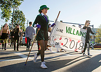 """The """"Riddler"""" Devon Mello leads the senior class of 2018 DC Villiains during Laconia High School's Homecoming parade Friday afternoon.  (Karen Bobotas/for the Laconia Daily Sun)"""