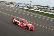 Matt Kenseth drives the Toyota (20) car during a NASCAR Sprint Cup race at Kansas Speedway, Sunday, April 21, 2013 in Kansas City, Kansas. (AP Photo/Colin E. Braley)