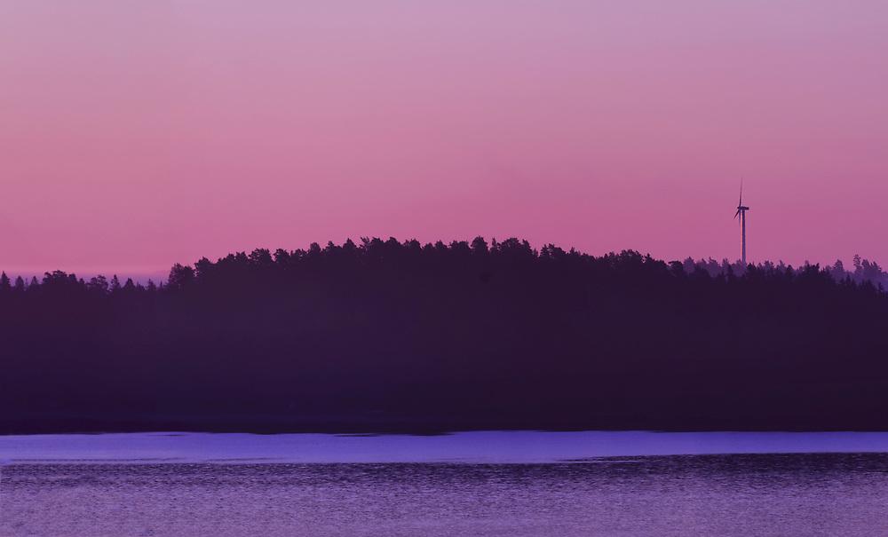 Wind turbine along the Swedish coast at sunrise in the Stockholm Archipelago, Sweden, Europe.
