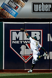 OAKLAND, CA - MAY 01: Khris Davis #2 of the Oakland Athletics catches a fly ball hit off the bat of Jason Castro (not pictured) of the Houston Astros during the fourth inning at the Oakland Coliseum on May 1, 2016 in Oakland, California. The Houston Astros defeated the Oakland Athletics 2-1. (Photo by Jason O. Watson/Getty Images) *** Local Caption *** Khris Davis